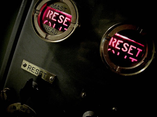 "Steampunk-style panel flashing the word ""RESET"" in red"