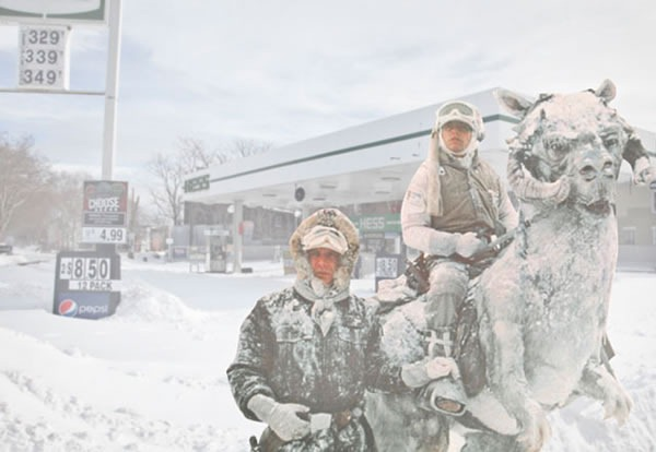 Snow-covered gas station in Williamsburg with Han Solo, Luke SKywalker and a tauntaun photoshopped into the foreground.