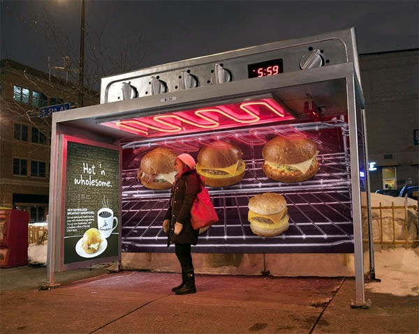 Bus stop done up to look like a large oven with baked goods and sandwiches