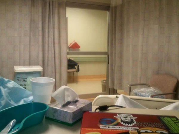 View from my ICU bed: table, door
