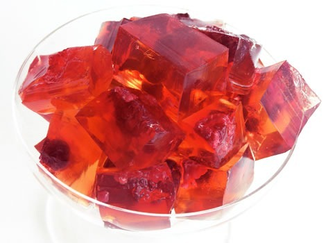 Glass bowl full of cubed red jell-o
