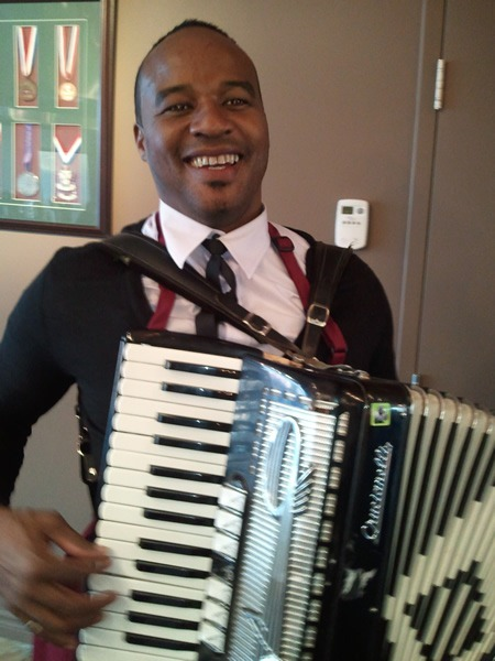 Gladstone Grant plays the accordion