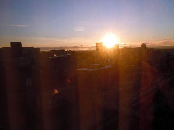 The sun rising over the Seattle skyline