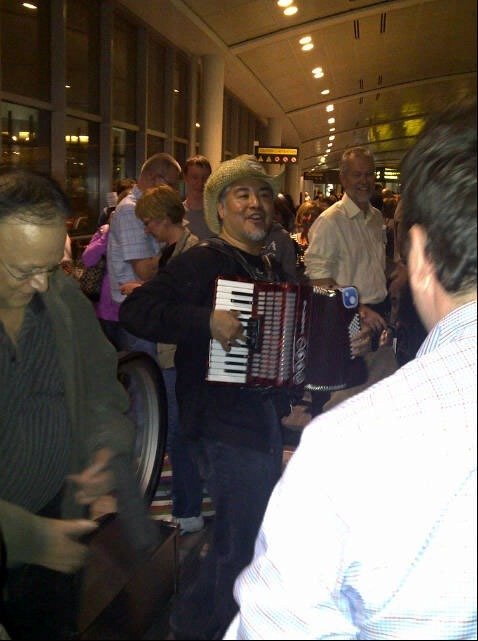 joey in customs line on accordion