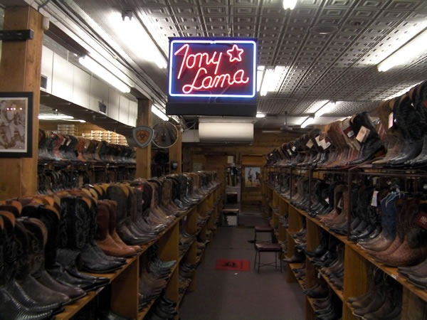 "Boot aisle at Allen's Boots, featuring a big neon ""Tony Lama"" sign"