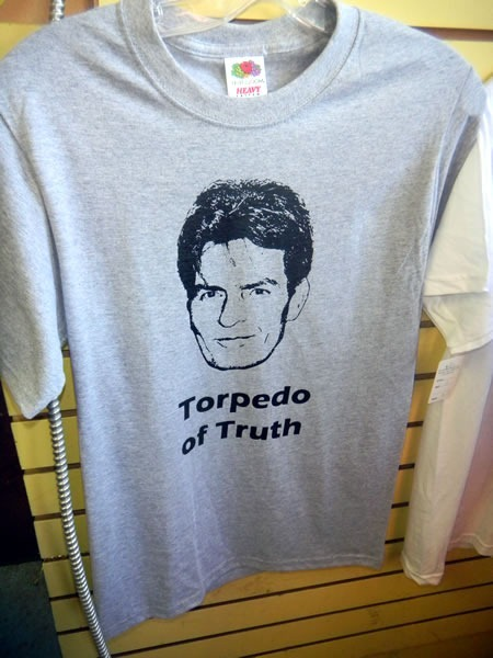 "Grey T-shirt with illustration of Charlie Sheen's face, captioned ""Torpedo of Truth"""