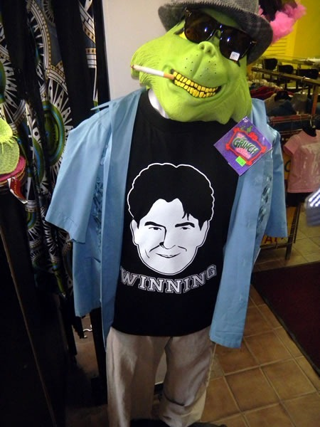 "Black t-shirt with drawing of Charlie Sheen's face, captioned ""Winning"""