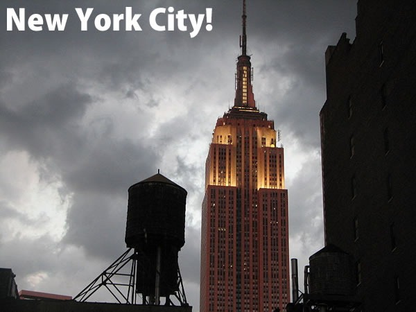 New York City!: The Empire State Building, lit up on a cloudy day.