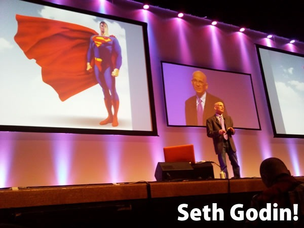 Seth Godin!: Seth Godin giving a presentation on stage in front of an image of Superman