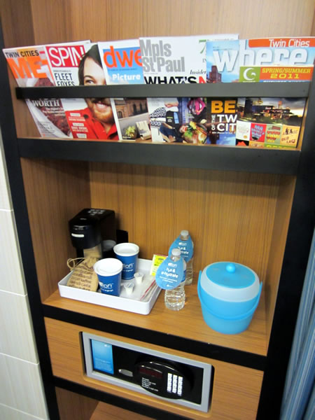 Closeup of the magazine rack, beverage shelf and safe in the closet