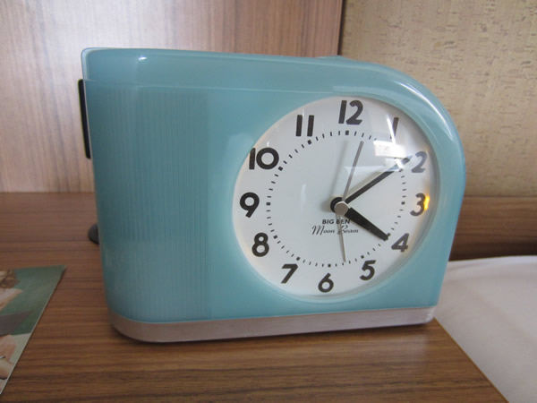 Closeup of 1950s-style alarm clock