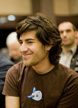 Photo of Aaron Swartz in a brown Google App Engine t-shirt.
