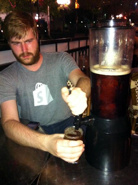 Brian alkerton pulls a beer
