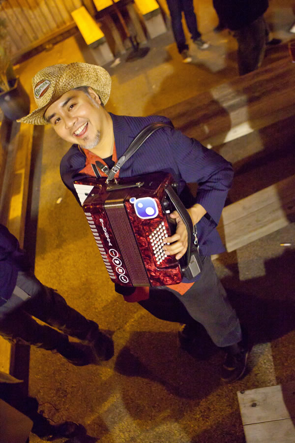 Joey deVilla in a cowboy hat, playing his accordion at an Austin Bar at South by Southwest 2011. Photo by Kris Krug.