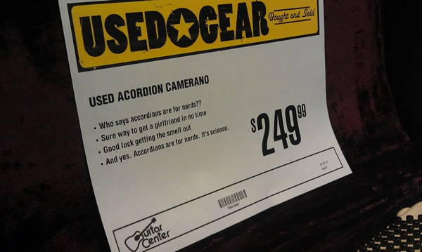 Guitar Center price sign: Used Acordion [sic] Camerano | Who says accordians [sic] are for nerds?? | Sure way to get a girlfriend in no time | Goo dluck getting the smell out | And yes, Accordians [sic] are for nerds. It's science.