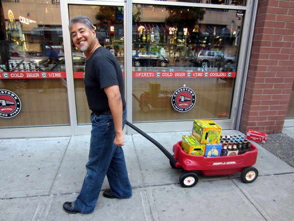Joey devilla pulling a red wagon full of beer