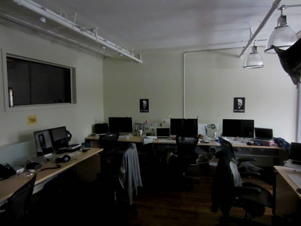 The empty desks of Shopify's design team room