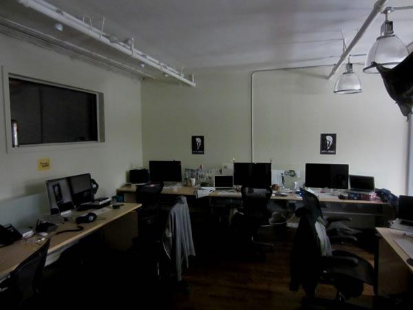 The empty desks of Shopify's design team room