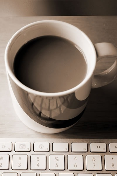Mug of coffee and an Apple wireless keyboard