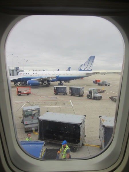 View from an airplane window, looking at a United Airlines jet at O'Hare