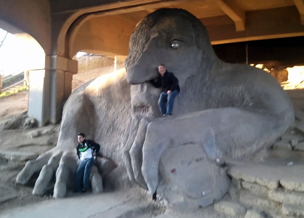 Joey deVilla poses with the giant troll under the bridge in Seattle, with his arm up the troll's left nostril