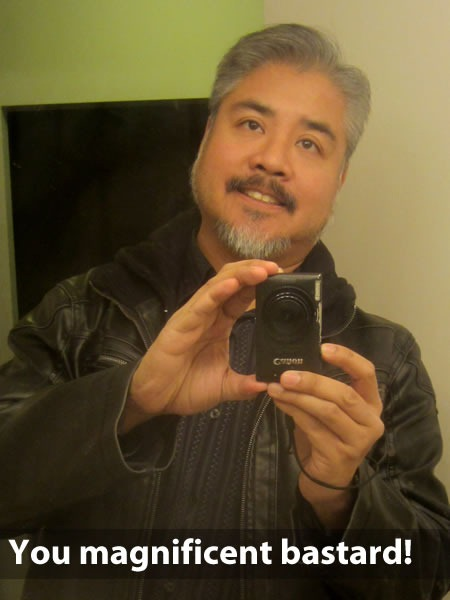 Joey deVilla, with moustache, taking a self portrait in a mirror