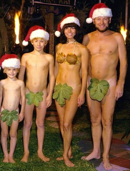 Family of 4 posing in Santa hats, fig leaves and nothing else.