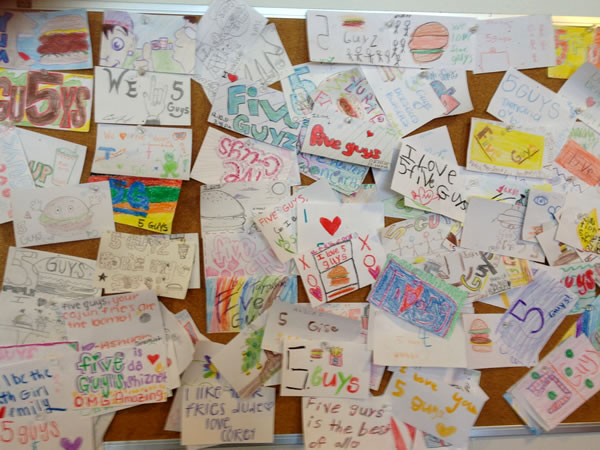 The 'compliments' bulletin board at a Five Guys in Tampa.