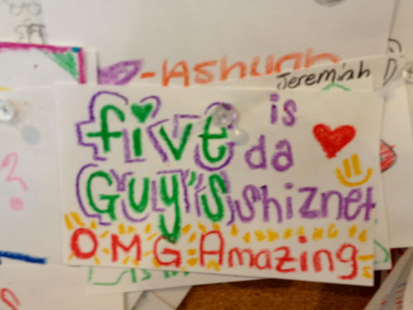 Card on the Five Guys 'compliments' board that reads 'Five Guys is da shiznet'.