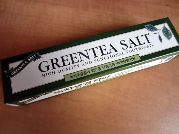 "A box of ""Greentea Salt"" toothpaste, with the text ""High Quality and Functional Toothpaste"""