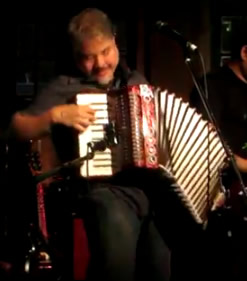 Joey deVilla plays accordion at the Fandango party