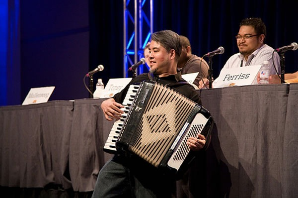 "Joey deVilla plays accordion at the ""How to Rawk SxSW"" panel as Rannie Turingan looks on"