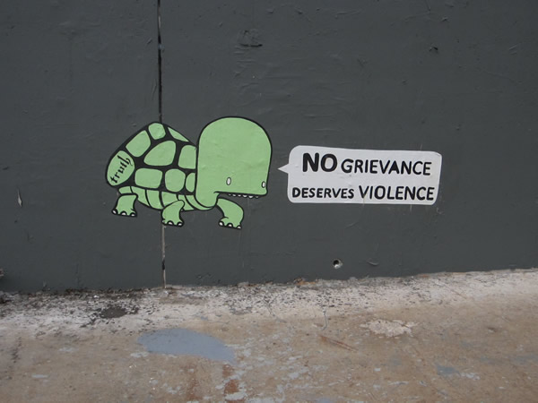 """""""No grievance deserves violence"""" graffito"""