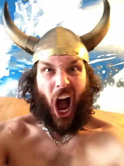 Robert Wilkinson, screaming and wearing a viking helmet