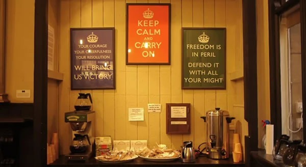 Wall in Barter Books displaying all three framed posters