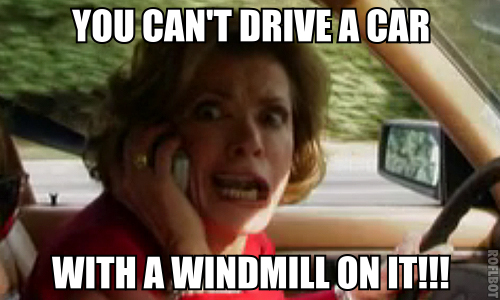 """Lucille"" from ""Arrested Development"" driving a car, yelling on her mobile phone, captioned with ""You can't drive a car with a windmill on it!"""