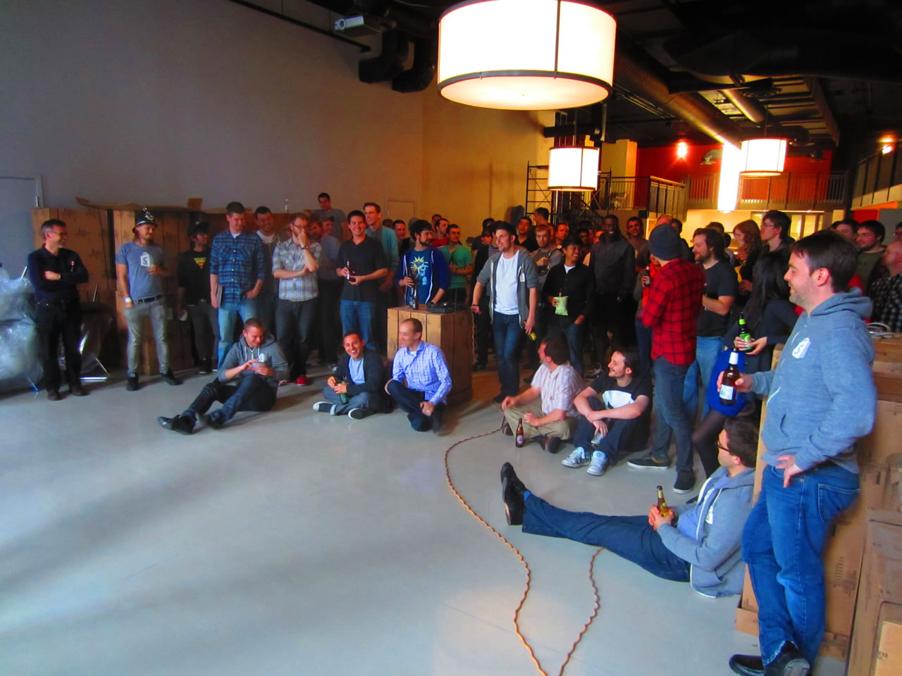 Shopify employees watching an all-hands presentation