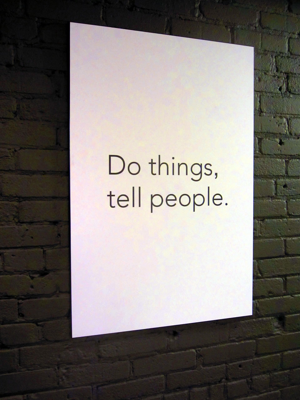 "Poster in the Shopify office: ""Do things, tell people."""