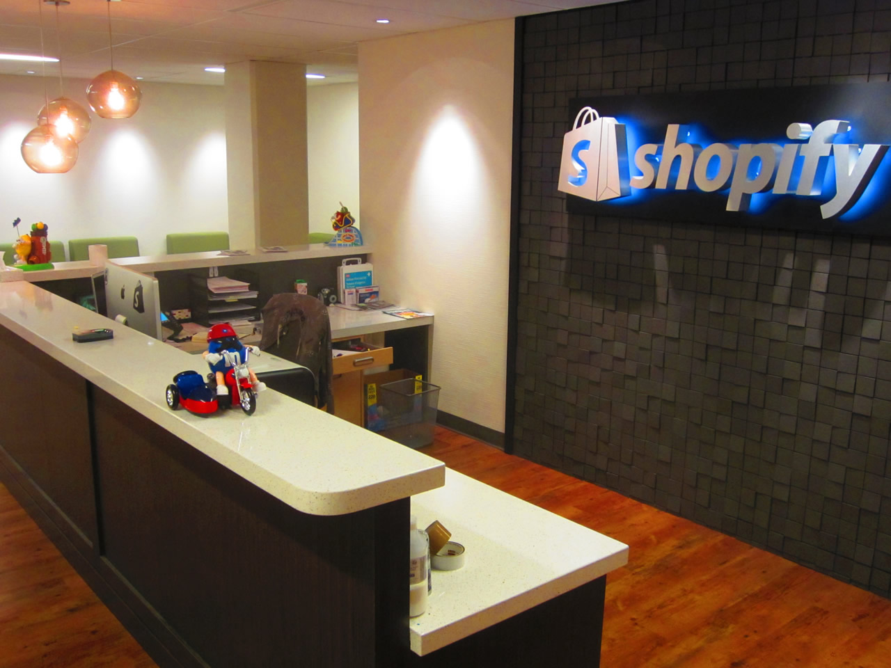 Shopify office lobby, with the front desk front and center