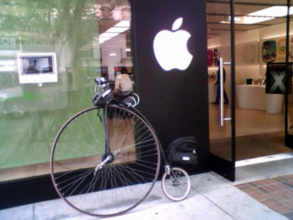 Penny-farting bicycle parked outside the Apple Store