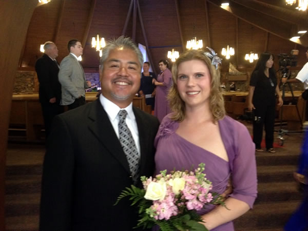 Joey deVilla and girlfriend in bridesmaid's dress.