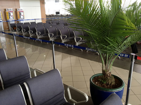 """Velvet rope"" cordoning off departure gate seating area at Ninoy Aquino International Airport"