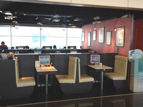 Tables with TV screens at Beef Noodle restaurant in Hong Kong airport