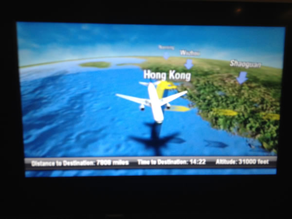 Cathay Pacific entertainment system map showing plane over Hong Kong