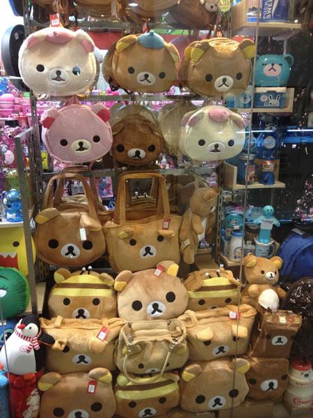 Cute purses and knapsacks shaped like teddy bear heads