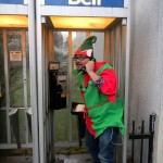 Rannie Turingan in an elf costume in a pay phone