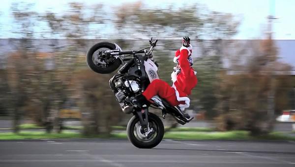 Photo: Santa on a motorbike, popping a wheelie