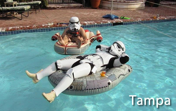 Tampa: Star Wars stormtroopers in a pool, lounging on floating landspeeder and Millenium Falcom pool toys