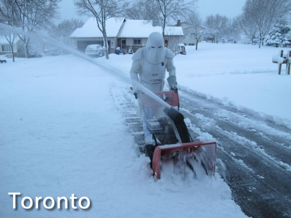 Toronto: Star Wars snowtrooper snowblowing a driveway