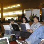 Aaron Swartz and Wes Felter, deep in their laptops at the conference hotel lobby.